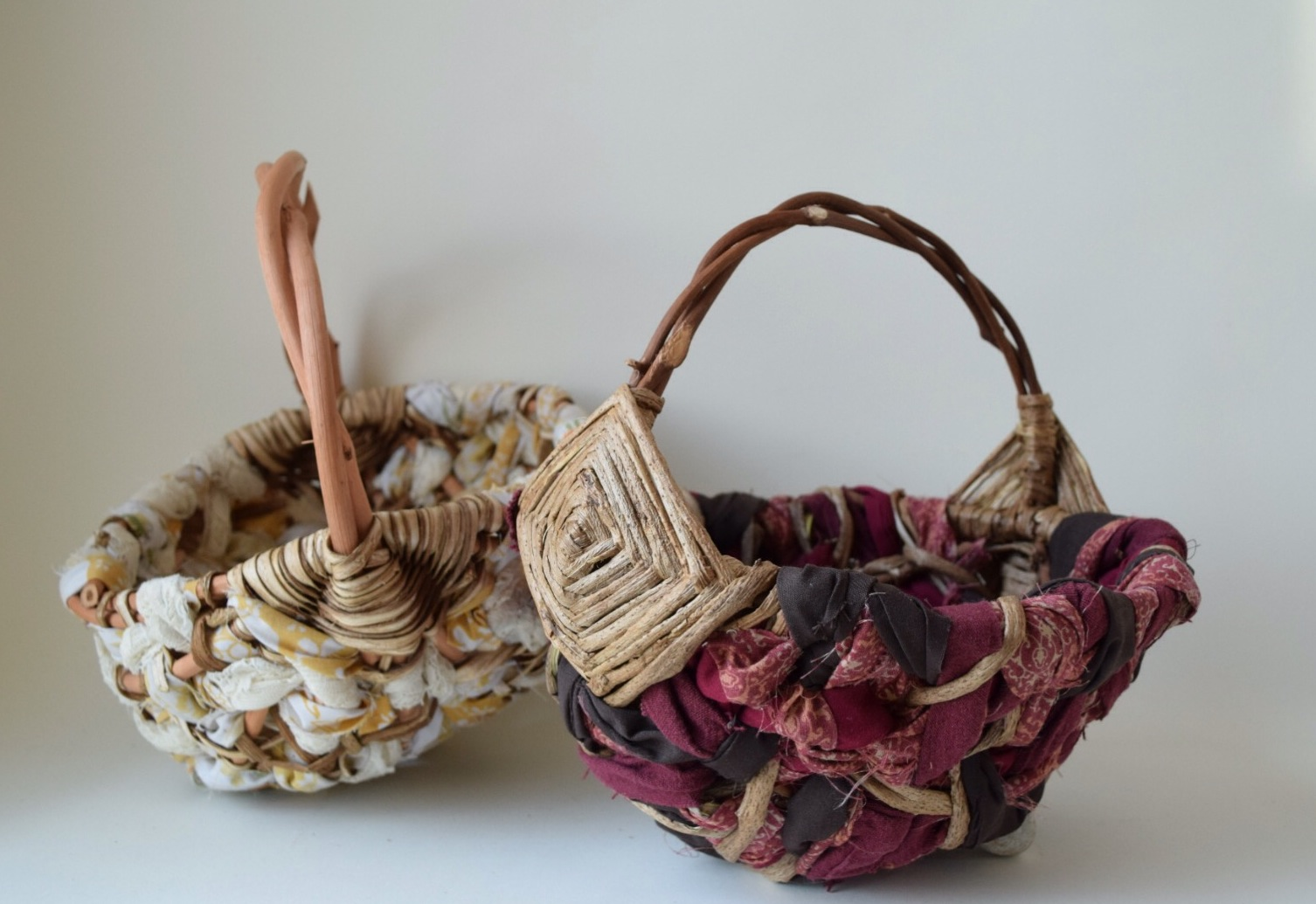 two fabric and vine egg baskets