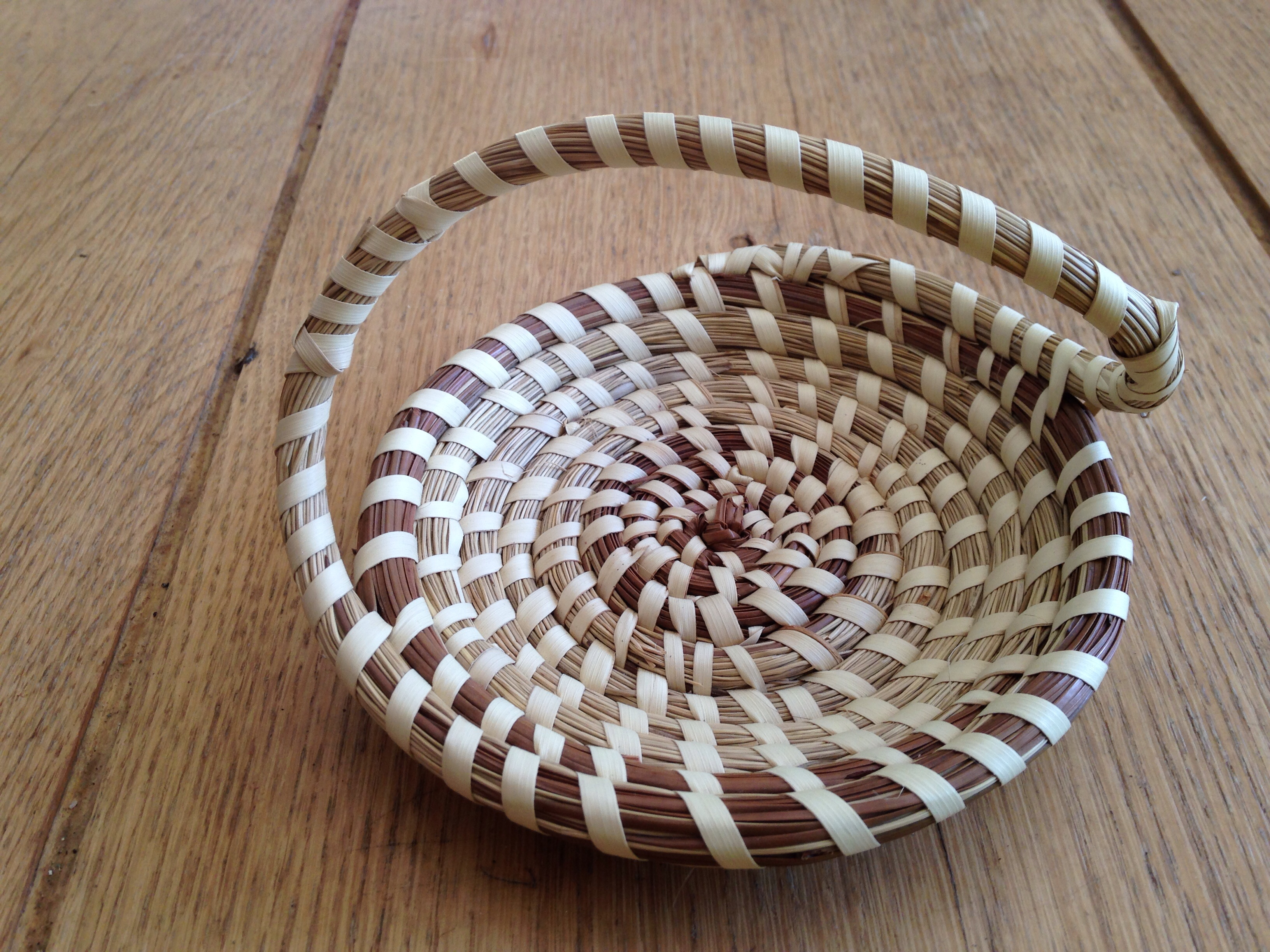 Coiled sweetgrass and pine needle basket from Charleston