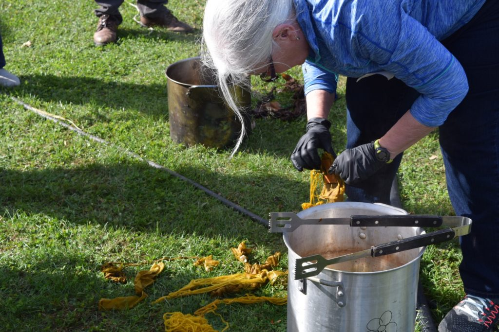 taking out the marigold dyed yarn
