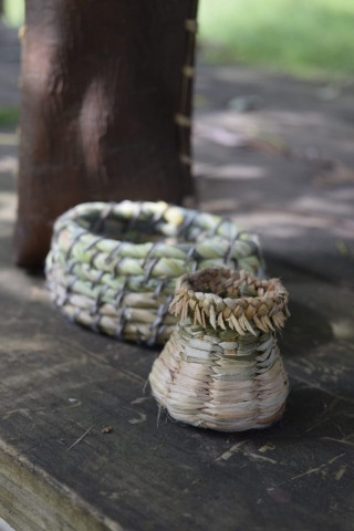 a twined basket with a beautiful braided rim