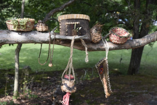 a tree covered in beautiful baskets, coiled, twined, and folded pine bark